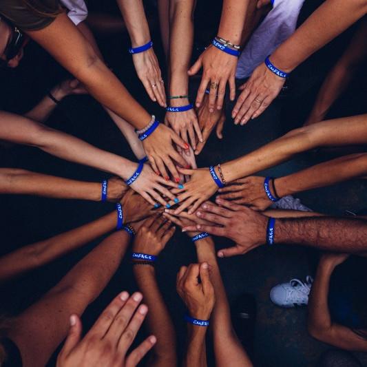 Many hands volunteering